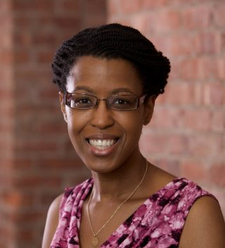 Profile picture of Gail Drakes smiling in front of brick wall